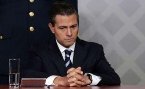 Enrique_Pena_Nieto ardently listens to his chagres before he is connvicted and his executed in 2012